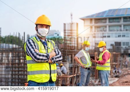 Team Work Of Construction Engineers Technician And  Architect Supervising Progress Stand In Control