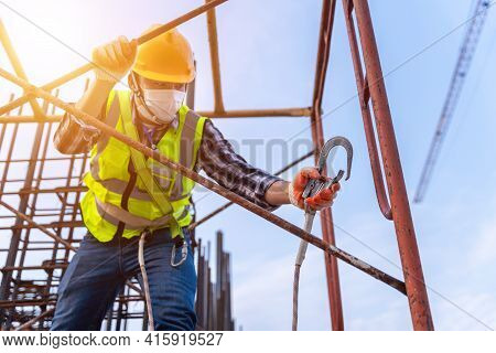 Worker Working At Height Equipment Constructive At Construction Site. Fall Arrestor Device For Worke