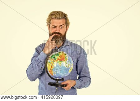Travel By Air. Around The World. Travel And Wanderlust. Bearded Man With Globe. Earth Day. Internati