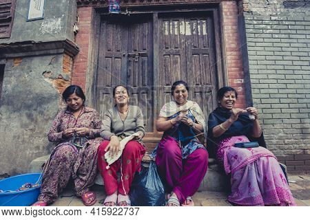 Bhaktapur, Nepal, April 25: A Group Of Women In Bhaktapur Smiling And Working In The Street. Bhaktap