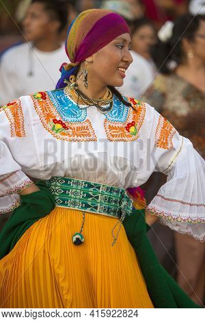 Puerto Ayora, Galapagos, February 13: Unidentified Woman With Traditional Costume Dancing In The Str