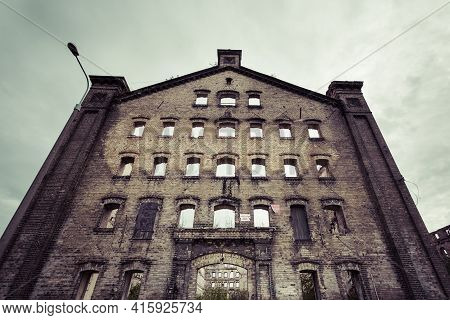 Ruined And Abandoned Industrial Building In Gdansk Shipyard Area. Poland