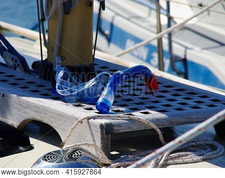 Blue Leisurediving Mask And Snorkel On A Yacht - Great Summer Sea Sports Vaction Background Image
