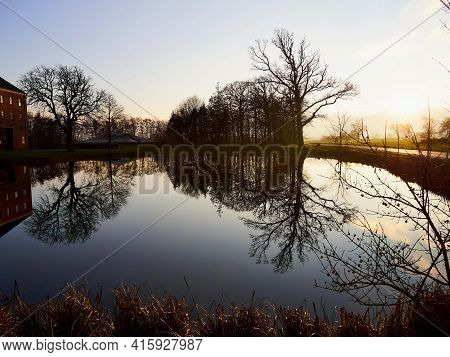 Agriculture Farm Mansion House Reflection In A Calm  Lake In Funen Denmark