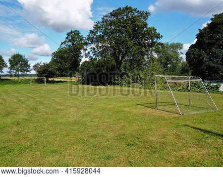 Small Football Soccer Field For Paly And Training Surrounded By Green And Trees