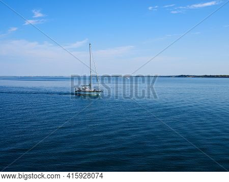 Sailing Yacht Boat Sailing On The Ocean Sea With Beautiful Calm Water