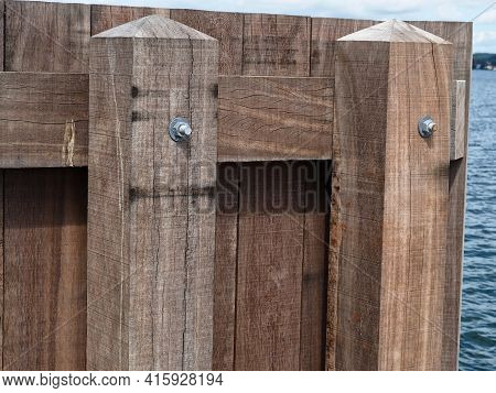 Wooden Dock Breakwall In A Marina Harbor Sailing And Boating Background Image