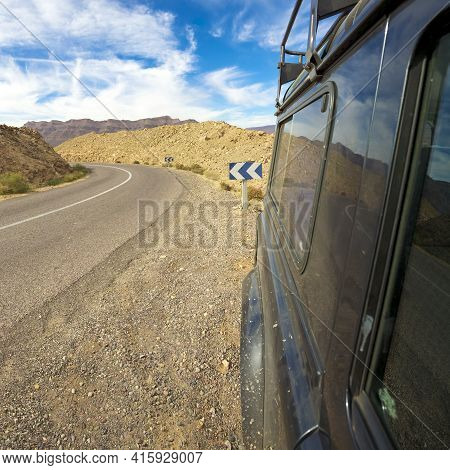 Road To Ouarzazate With Short 4x4 Land Rover Defender With Clear Blue Sky, Rear View. Morocco