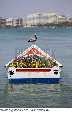 Margarita, Venezuela, April 15: Pelican Standing On A Fisher Boat In The Bay Of Pampatar. Isla Marga