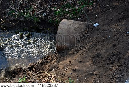 When Building A New Road, It Is Necessary To Bridge The Stream With The Help Of A Metal Pipe Only Fo