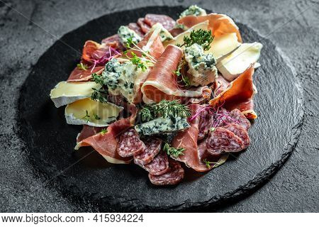Antipasto Board With Sliced Meat, Ham, Salami, Cheese For Red Wine. Traditional Spanish Meat Snacks