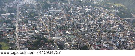 Aerial View Of Banos De Agua Santa, A Small City In The Andean Highlands Of Ecuador Under The Smoke