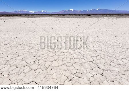 Land With Dry And Cracked Ground. Pampa Of El Leoncito