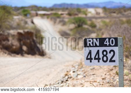 Distance Sign Road On Gravel Road On The Famous Ruta 40 (route 40) Within Calchaqui Valleys In Salta
