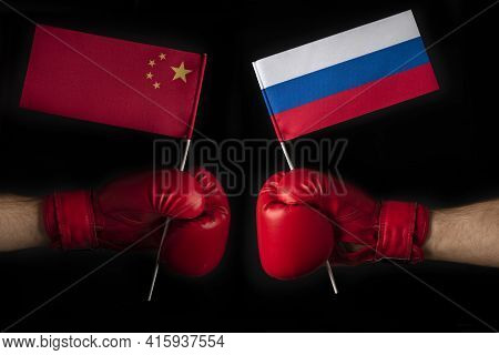 Boxing Gloves With China And Russian Flag. Russian Federation And The China Confrontation And Relati