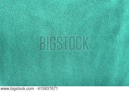 Green Homogeneous Fleece Background. Textile Surface. Cloth