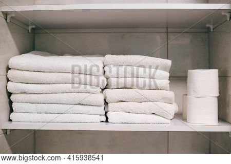 Clean Towels On Shelf In Bathroom. White Towels On The Shelf. Stack Of Neatly Folded White Towels. C