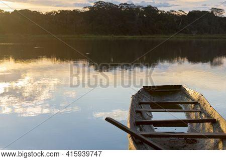 Sunset On A Lake With Canoe, Madidi National Park. Bolivia