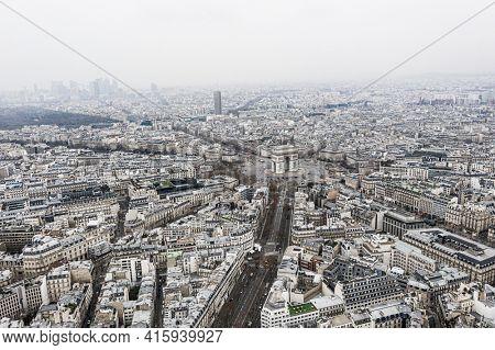 Paris, France, January 16, 2021 - Aerial view of Arc de Triomphe, Paris and defense neighborhood.