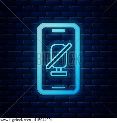 Glowing Neon Mute Microphone On Mobile Phone Icon Isolated On Brick Wall Background. Microphone Audi