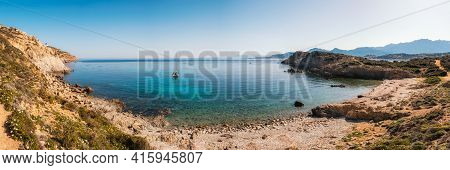 Panoramic View Of A Sailing Yacht Is Moored In A Bay On The Translucent Mediterranean Sea On The Coa