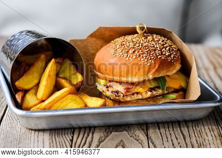 Burger With.french Fries. Burger With Beef, Cheese, Bacon. Lunch Is On The Table.close-up Of A Hambu