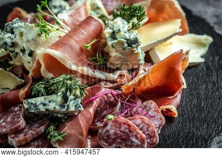 Antipasto Background. Different Italian Snacks For Wine On Dark Background. Traditional Spanish Meat