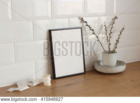 Spring Still Life. Blank Picture Frame Mockup On Wooden Table Background. Easter Composition With Bl