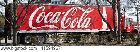 West Islip, New York, Usa - 6 April 2021: Side View Of A Large Coca Cola Truck Delivering Soda And P