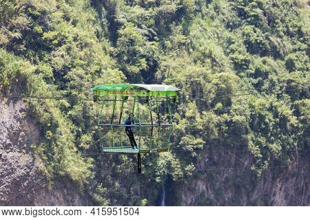 Banos, Ecuador, February 21: Single Young Woman Standing In The Cable Car Used For Observing Agoyan