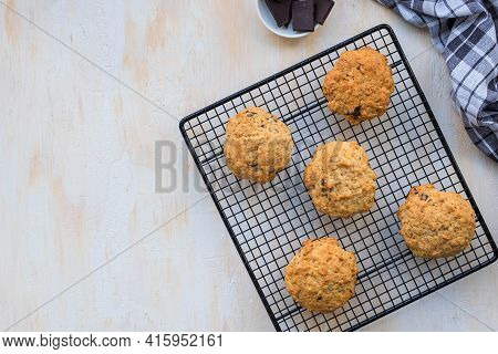 Homemade Oatmeal Cookies With Banana And Chocolate On A Black Wire Rack On A Light Concrete Backgrou