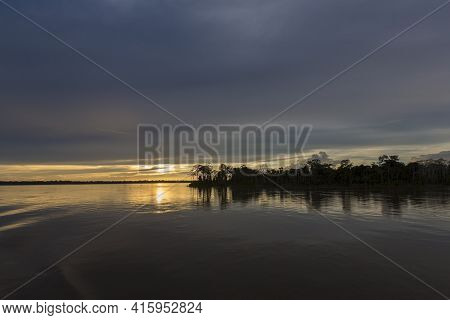 Colorful Sunset On The River Amazon In The Rainforest, Brazil