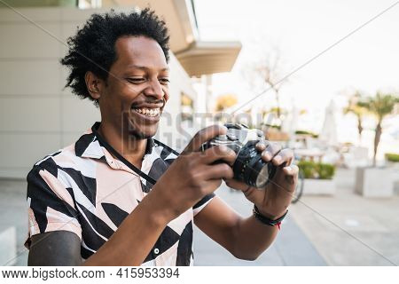 Afro Tourist Man Taking Photographs With Camera