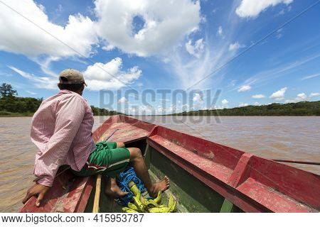 Rurrenabaque, Bolivia, January 9: Indigenous Bolivian Man Traveling On A Wooden Boat On Beni River I