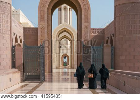 Muscat, Oman - 04.04.2018: Three Muslim Women In Traditional Black Dress Entering The Grand Mosque O