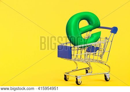 E-commerce. Empty Mini Shopping Trolley, Shopping Cart, On A Yellow Background. Rfi Request For Info