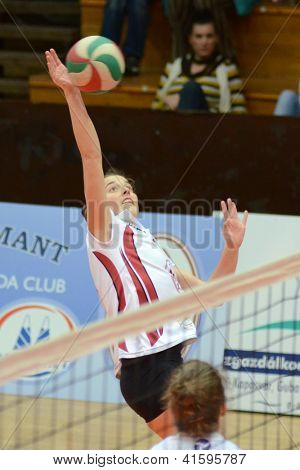 KAPOSVAR, HUNGARY - JANUARY 27: Zsanett Pinter (2) in action at the Hungarian I. League volleyball game Kaposvar (white) vs Ujpest (purple), January 27, 2013 in Kaposvar, Hungary.
