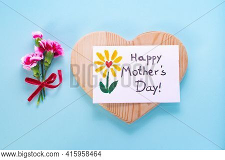 Mother Day Card, Bouquet Carnation, Heart Wood . Text Happy Mothers Day. On A Colored Background. Po