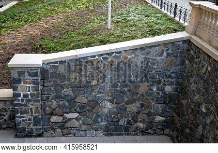 Snowy Benches Near The Retaining Wall, Concrete Gray In The Park. Balustrades And Magnificent Restor