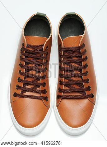 Perspective View Of Pair Brown Sneakers