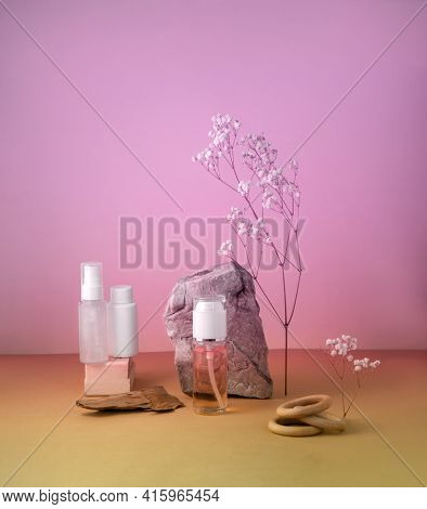 Cosmetics Bottle With Gel Or Other Cosmetic Product, Stones, Dried Plant Flowers And Wooden Decorati