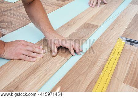 Wood Laminate Flooring Installation: Laminate Flooring Installers Are Installing Laminate Hardwood P
