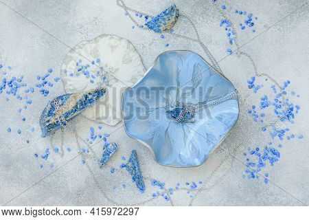 Resin Art Plate And Blue Stones On Gray Background. Epoxy Resin Art. Flat Lay, Top View