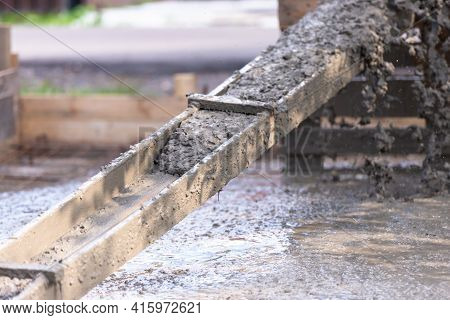 Pouring Concrete Slabs. The Concrete Is Drained Through A Makeshift Wooden Tray From A Concrete Mixe