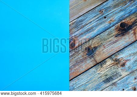 Light Blue Cardstock On An Old Wooden Table In Antiqued Pastel Colors. Rustic Wooden Vintage Backgro