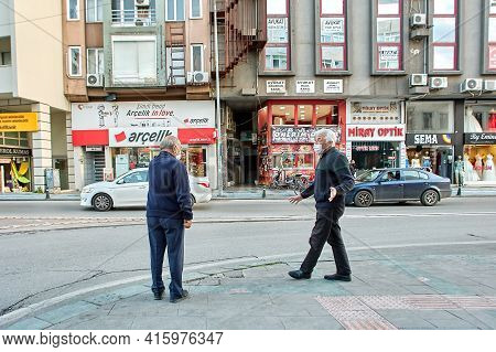Antalya, Turkey - March 19, 2021: Coronavirus Protective Measures, Two Elderly Men Wear Protective F