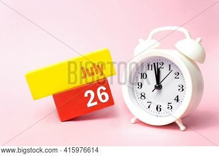 July 26th. Day 26 Of Month, Calendar Date. White Alarm Clock On Pastel Pink Background. Summer Month