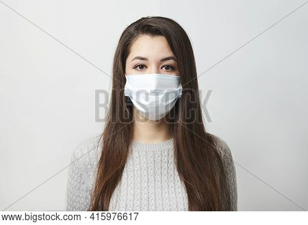 Young Woman Wearing Medical Mask, White Background.