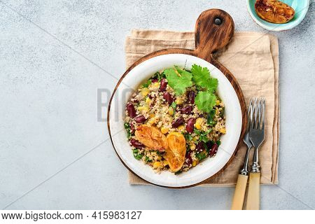Mexican Black Bean Corn Quinoa Salad With Caramelized Lemon In Old Vintage Clay Bowl On A Light Gray