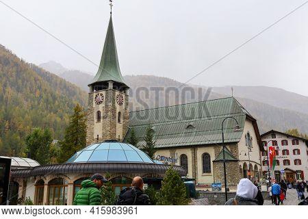 Zermatt, Switzerland-october 21, 2019:the Old Chuch Building On Zermatt Bahnhofstrasse Street In Aut